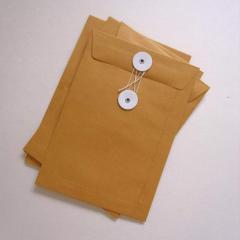 Eyelet string envelopes