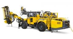 Drill rigs and rock drills. Cable bolting rigs.